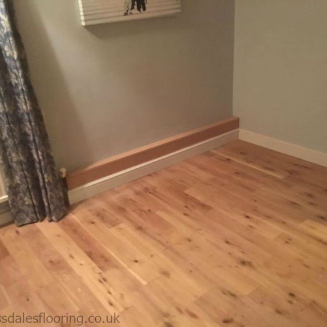 Real Oak Plank Flooring with MDF Skirting & Boxed in Pipes