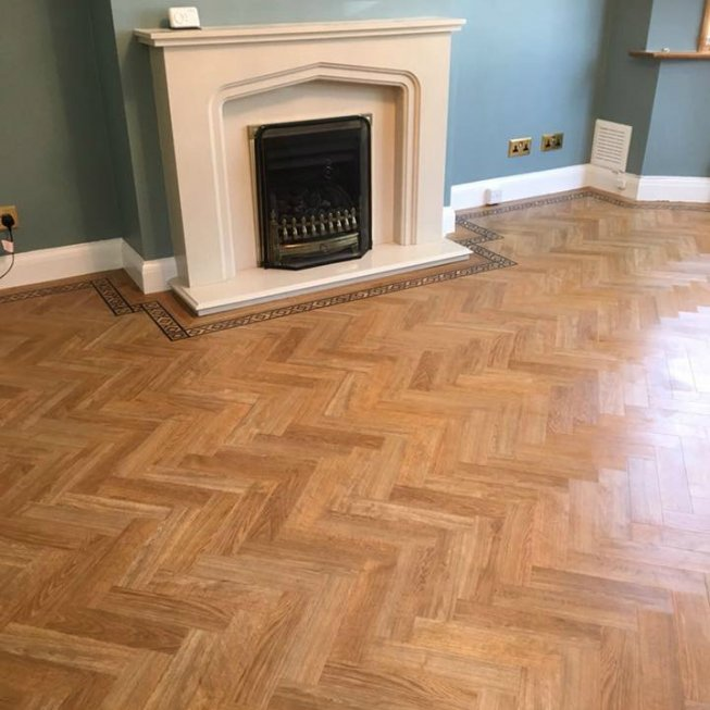 Amtico American Oak 9X3″ Herringbone Floor with Decorative Border
