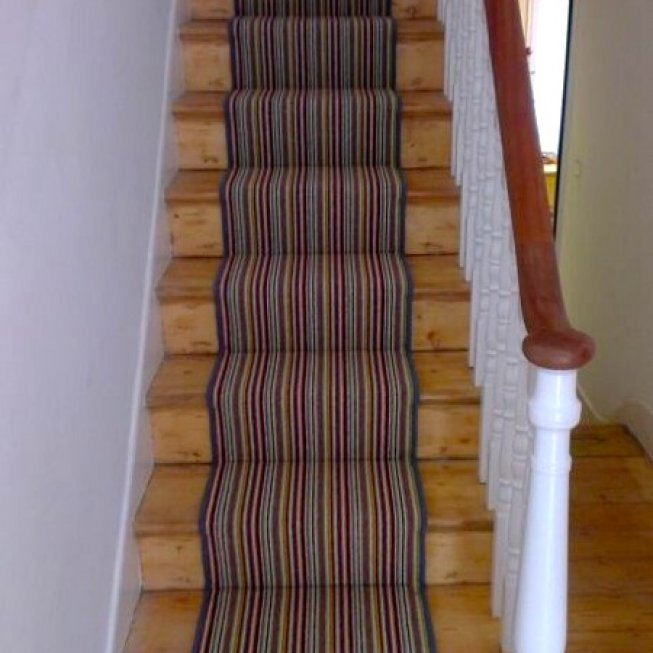 Striped Stair Runner on pine flooring